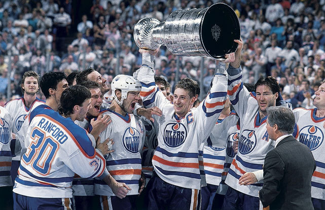 Wayne Gretzky is all smiles as Bill Ranford, Esa Tikkanen, Mark Messier, and Kevin Lowe look on after Edmonton defeated Boston in five games to claim the 1988 Stanley Cup. This year's Kings squad are one win away from a championship and could become the first No. 8 seed to win a Cup. They also have a chance to equal the 16-2 mark of the 1988 Oilers, the best mark since the NHL adopted the current format of four rounds of best-of-series. (David E. Klutho/SI) FARBER: Making sense of the LA KingsCAZENEUVE: Devils focus on Game 4FARBER: Penner playing up to his size