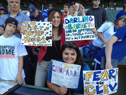 Angela Cusumano (left) and Alexandra Schloss couldn't pick one Cubs player to make a sign for the Cubs game against the Brewers in Milwaukee, so they made multiple.  Darwin Barney saw his sign during batting practice, gave a smile and said thank you to the loyal Cubs fans.