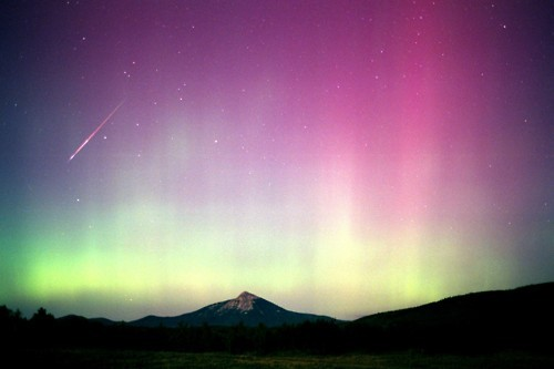 theastrophysicsblog:  Auroras Most well known as the Aurora Borealis (Northern Lights) and Aurora Australis (Southern Lights), auroras are some of the most beautiful naturally occurring phenomenon that our planet has to offer. Earth possesses a magnetic field, basically an electric dipole (having both North and South) tilted at 11 degrees with respect to the rotational axis. Auroras are caused by radiation from the sun, known as solar wind, interacting with this magnetic field. Charged ions are produced in the sun's corona, and are added to the solar wind. The magnetic field is strongest at Earth's poles, and that is why auroras are typically confined to these regions. Charged particles form the sun occasionally get caught in Earth's magnetic field as they pass by and interact. Once they are trapped in the upper atmosphere, they react with other gases and produce the famous lights. Collisions between the highly charged solar wind particles and atmospheric molecules causes energy emission, visible as light. Electrons in the molecules are excited to higher energy levels and then release photons when they fall back to lower energy levels. Each different reaction, causes by different ions colliding with air particles, causes a different color to result. For example, neutral nitrogen particles will create a purple-pink color, while ionic nitrogen results in a blue color. The most common aurora, a yellowish-green color, is causes by an ion crashing into oxygen at low altitudes.