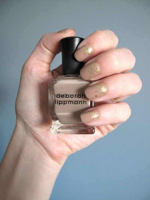 Fancy Nails!! - Neutral Nails   Deborah Lippmann - Fashion Deborah Lippmann - Boom Boom Pow   OPI - RapiDry TopCoat On Monday I went to the CFDA Awards.  I wore a bright orange dress so I wanted to keep my nails pretty neutral and minimal.   1. Apply two coats of Fashion and allow to dry.  2. Apply Boom Boom Pow to the base of the nail bed, close to the cuticle.  Use the brush to drag the polish up the nail bed slightly so most of the gold glitter is still concentrated at the base of the nail.  This polish only extends about half way up the nail.   3.  Apply OPI top coat.