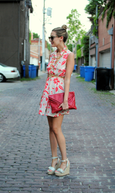 A bold red bag is the perfect complement to a tropically-inspired print! via See Jane.