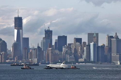 reuters:  The lower Manhattan skyline is seen behind the Space Shuttle Enterprise, being transported on a barge to dock at Weeks Marine in Port Elizabeth, New Jersey, for a four-day journey to the Intrepid Sea, Air & Space Museum in New York June 3, 2012. REUTERS/Eduardo Munoz PHOTOS: Enterprise on the Hudson    Space vessel meets sea vessel. I wonder where in the spaceship stands in the Colregs pecking order… WIG? Seaplane? Likely just a boring old tow…