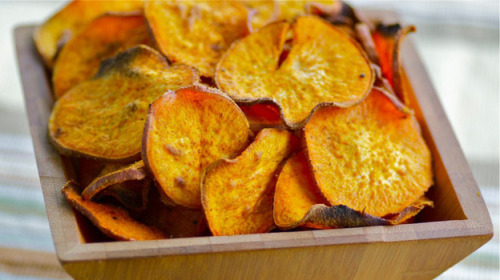 npr:  Chili-Lime Plantain Chips Photo Credit: Susan Russo for NPRMakes 4 servings:2 medium unripe plantains (they should be hard and green), thinly sliced 2 tablespoons olive oil 1/2 teaspoon chili powder (or Mexican/taco seasoning) 1/4 teaspoon salt The zest of 1 small lime Preheat oven to 350 degrees. For easy cleanup, line a large rimmed baking sheet with parchment paper. Place plantains in a large bowl and, using your hands, toss with oil and seasonings until coated. Arrange in a single layer on the prepared baking sheet. Bake for 15 to 20 minutes or until golden and crisp. Remove from oven and eat.Click here for more Vegetable Chip Recipes from NPR's Kitchen Window  I feel there's a high possibility that I will make these later today. Will report back on recipe quality.