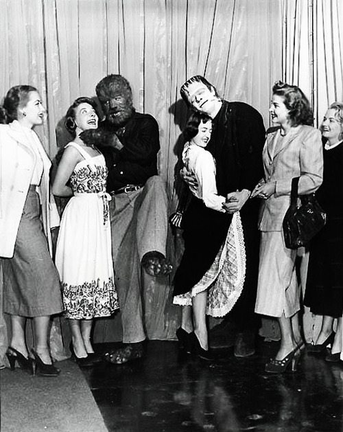 "vintagegal:  Glenn Strange and Lon Chaney, Jr. find a couple of girls to dance with during the production of ""Abbott and Costello Meet Frankenstein"" (1948)  Best prom ever."