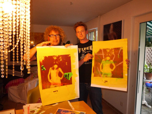"Up late last night signing prints with Swiss pop artist Marco Pittori in Basel last night. Our Nude Hollywood exhibition opens tomorrow night with a reception 5-8pm at Galerie Eulenspiegel. Come out and say ""hello""! That's Dora Yoder with her gas mask in my garden!  Photo: Brad Elterman Archives"