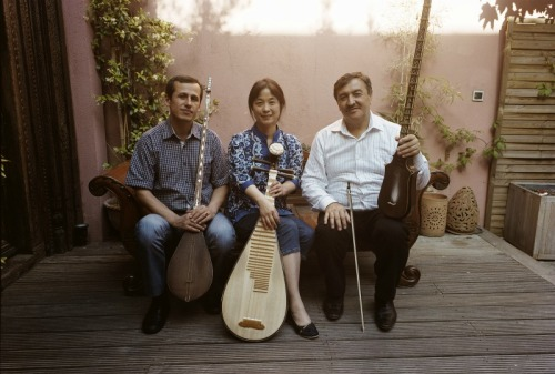 hearthmusic:  Chinese pipa master Wu Man with Tajik musicians Abduvali Abdurashidov and Sirojiddin Juraev. From the new Music of Central Asia Vol 10 from Smithsonian Folkways.  Wu Man is one of the headliners for this year's Concert of Colors event in Detroit! She plays at the Detroit Symphony Orchestra on Sunday, July 15 at 3:30 pm and it's FREE! Check it out at ConcertOfColors.com