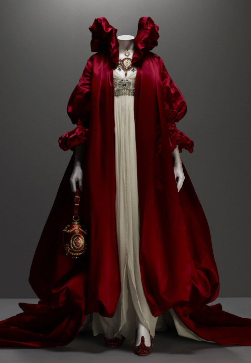 Coat of red silk satin; dress of ivory silk chiffon embroidered with crystal beads - Alexander McQueen, fall 2008