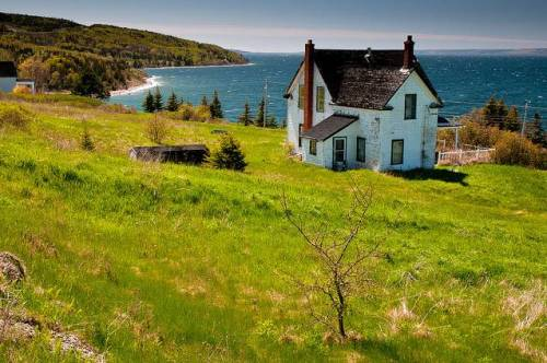 Old house with a view (Cape Breton) Many old farm houses are left to decay on Cape Breton as an older generation dies off and younger people move to more prosperous parts of the country. Some, like this house by Bras d'Or Lake, have million dollar views. photo and text by Richard McGuire