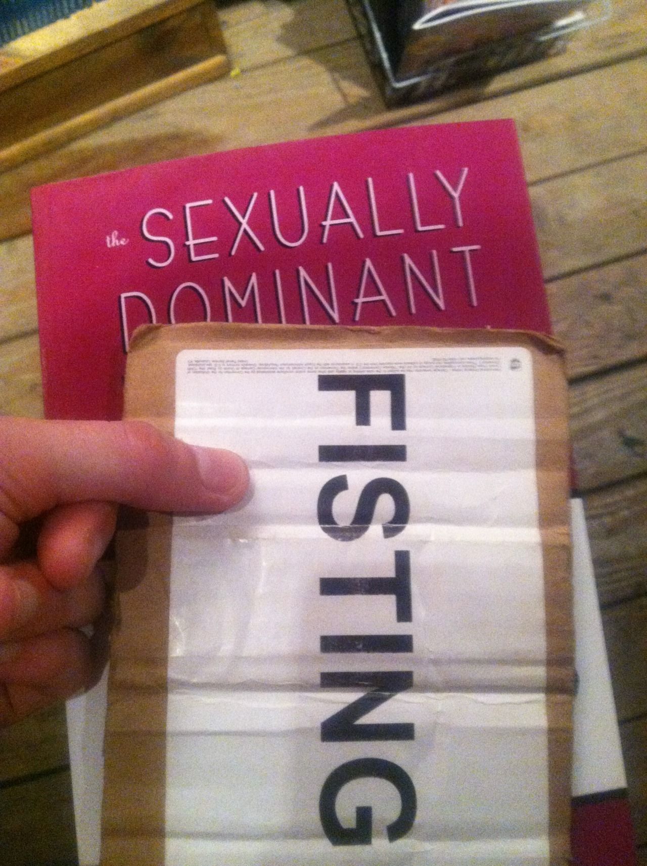 I got the LGS a book, The Sexually Dominant Woman: A Workbook for Nervous Beginners  And, inspired by the token they gave me at the bag check, I think I'll fist her if she can't manage to learn something from it…