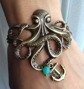 newb-liefs:  tangled & bangled / Octopus Cuff - Style on We Heart It. http://weheartit.com/entry/29565765 I want this so bad.
