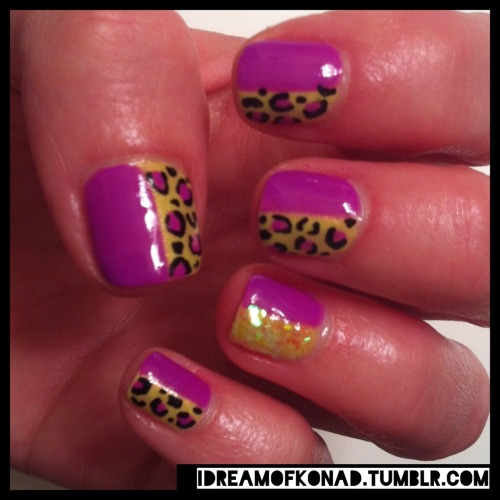 "Check out my Jerseyliscious inspired nails! I've been obsessed with leopard nails recently so this mani is done just in time for the start of Warped Tour. At least my nails will be stylish this summer when I'm sweating outside in the 100 degree heat! Color are: Gelish ""Coco Cabana Banana"" and Daisy Gel ""Butter Cup"". I also added in some yellow hex glitter on my ring finger to try something FUN! Do you like?!.."