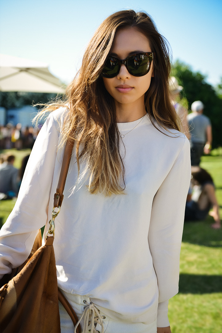 My very beautiful friend Rumi Neely (Fashiontoast.com) at Coachella in One Teaspoon lace-up shorts with a Deadly Ponies bag…