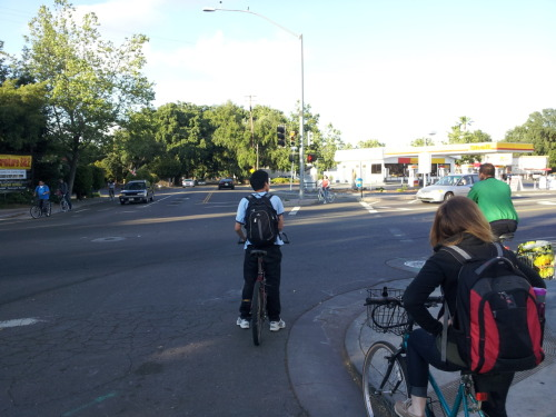 The `Speare Bearer: The Bike Intersection Showdown, Davis, CA 06/04 I've never seen so many bikes randomly at one intersection before. Including myself, there were at least 4 other bicyclists that you don't see in this photograph waiting at this light. Davis, California sure is serious about it's biking.
