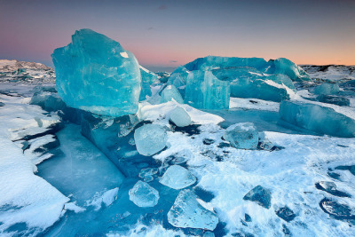 irkajavasdream:  Ice Boulder Field - Jökulsárlón, Iceland by orvaratli on Flickr. Via Flickr: This must be my favorite place and time to photograph. Jökulsárlón in winter is a magical place when conditions are right. A maze of frozen colorful ice sculptures which changes each time you are there. Here the blue light after sunset enhanced the deep blue color of the icebergs. The endless rain here in Iceland now has forced me to go digging in the archives. It is good to do this at least once a year because you generally look at your images differently months after they where shot since the positive experience of the trip and the photo shooting has faded away. If you have not seen it yet I wrote a blog post about this frozen world earlier this year: Frozen World