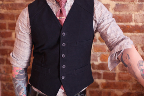 thedapperanddandy:  (via ThisFellow)  A tie clip complimenting a waistcoat inevitably leads to horrible placement in the top quarter of the torso.  But that's the least of homeboy's problem—what the fuck is up with that Merrill Hodge-esque knot?  And why the fuck does it have faux-quilted lines running through it?  It looks like a God damned cow heart for Christ sakes.  In closing, you shouldn't even be mad at that bottom button after taking into consideration the fact that this man is a walking abortion.