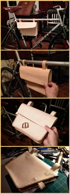 I wanted to try to make a leather bag for my bike to hold whatever the night requires.  Whether that be a bike lock, a flask, a sandwich, or a camera, it seems to work.   I'm going to make a smaller copper buckle to close the flap tomorrow.  It got late because I was sitting around using my brain to figure all of this out.