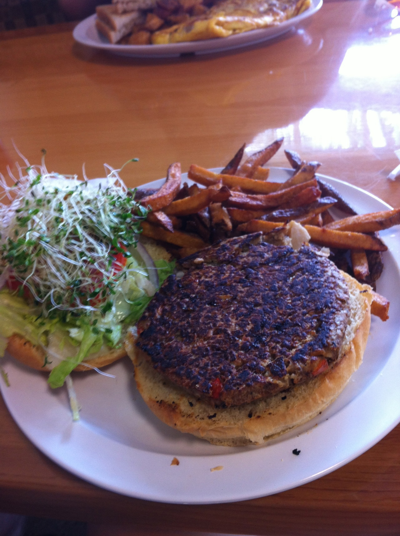 veggie burger with sprouts and fries at cocos in delray beach, fl