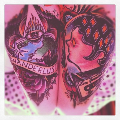 here's my thigh tattoos, i love them so much. they're both done by the nicest guy ever Joe Ellis at Cock a Snook Tattoos in Newcastle.They just represent how much I love travelling and music.