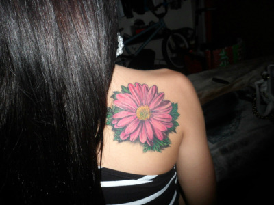 My gerber daisy tattoo in honor of the Electric Daisy Carnival festival, & the long & crazy journey I've experienced through raves. Done by Tu at Six Feet Under in Upland, CA. -comecatchafeeling