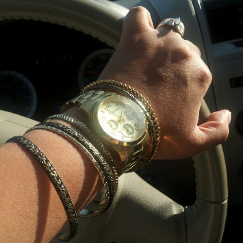 Today's #armparty #bangles and #MichaelKors #watch #mk keeping it #simple #jewelry #armcandy #fashion #nofilter #ring #gold #black  (Taken with instagram)