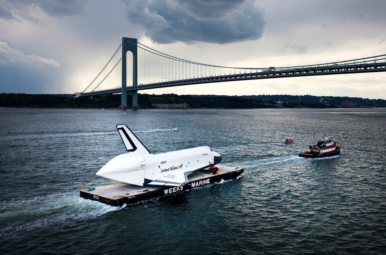 From Shuttles Sail to Their New Homes, one of 22 photos. Space Shuttle Enterprise is carried by barge underneath the Verrazano-Narrows Bridge in New York City, on June 3, 2012. Enterprise was on its way to the Intrepid Sea, Air and Space Museum, where it will put on permanent display. (Michael Nagle/Getty Images)