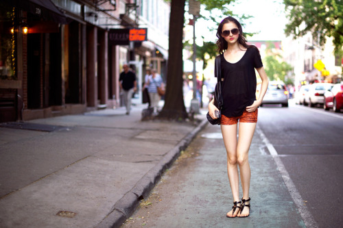 maybelline:  She's discovered the short cut to cool style in python shorts and sleek aviators. Her pink pout and rosy cheeks add a feminine twist.