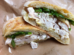 Incredibly juicy rotisserie chicken sandwich with caramelized onions.