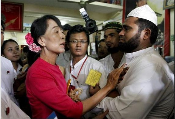 Bag's Take-Away:  I thought this photo of Aung San Suu Kyi talking to a Myanmar Muslim leader had a certain foreboding about it. Then I looked at the hands: his on his heart, hers over it and think there may be hope for stifling religious strife in Myanmar. via Reuters Editor's Choice (credit: Soe Zeya Tun/Reuters caption:  Myanmar's pro-democracy leader Aung San Suu Kyi talks to Myanmar Muslims leaders at the National League for Democracy head office in Yangon, Myanmar, June 6, 2012.) Visit BagNewsNotes: Today's Media Images Analyzed ————— Topping LIFE.com's 2011 Best Photo Blogs — also follow us on Twitter and Facebook.