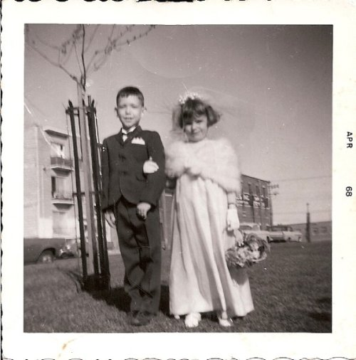My mom, the flower girl, with the upstairs neighbour.