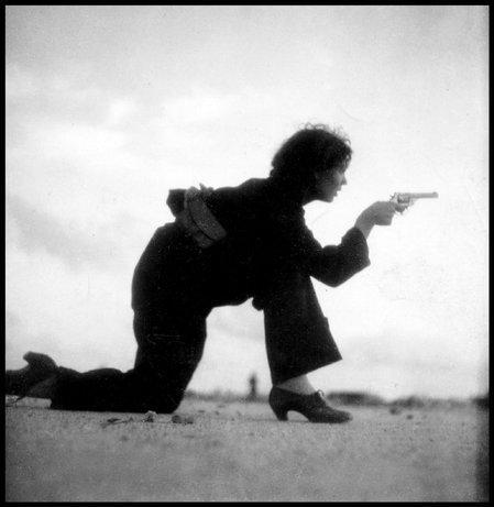 fyeah-history:  A Republican militiawoman trains on the beach outside Barcelona, Spanish Civil War, August 1936