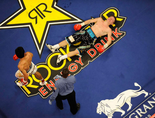 siphotos:  Manny Pacquiao retreats to his corner after knocking out Ricky Hatton during the second round of their 2009 fight. Will Pacquiao have as much success against Timothy Bradley when the two face off on Saturday? (Neil Leifer/SI)  GRAHAM: Crash course - all you need to know for Pacquiao-BradleyPOLL: Make your prediction for Saturday's Pacquiao-Bradley fightGALLERY: Pacquiao and Bradley arrive in Las Vegas