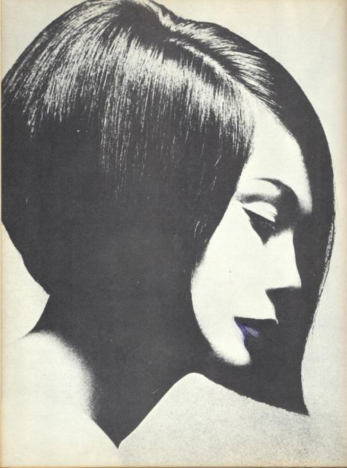 "© Terence Donovan, ca. 1962, Vidal Sassoon hair cut, Nancy Kwan Scanned from Bronwen Meredith's ""Vogue - Body and Beauty Book"" (1977). The hairstyle is named for Nancy Kwan for her role in ""The Wild Affair"" (1963).  I saw this picture on Tumblr today - it's the profile pic of frenchtwist (a nice blog for mainly black and white photography). Like it happens sometimes, the picture didn't leave my mind the whole day long; so I drag-and-dropped it into Google Image Search. Research brought up some interesting stories about the picture, here is one of them:   ""(…) Seven Arts film people telephoned to say, ""We'd like you to cut Nancy's hair for her role in The Wild Affair."" ""Fine,"" I said. ""Let's get together this week and talk about it.""""No time for chat,"" they said. ""We want to come around right away."" Two hours later a small army arrived - managers, agents, photographers with their various assistants, and John Krish, the director. There were so many of them that it was quite a while before I saw Nancy, who was looking completely enigmatic about the ordeal ahead of her. It was an ordeal. She had the most wonderful thick, strong hair, so long that she could sit on it. Now she was going to lose it in the name of entertainment.    Vidal Sassoon in action in his Grosvenor House Studio, Autumn 1962 (source)   She sat down quietly. Her manager called for a little table, and as I got ready to work, he produced a chessboard and began setting up the pieces. As I used barber's shears on that magnificent rope of black hair, she never raised her head. She moved only when she stretched out a hand to move one of her chessmen. She won, and I think I won, too. The game and the cut finished almost simultaneously. Nancy stood up and gazed at herself for a full minute in the mirror. Then her reflection smiled out at me. As soon as they had gone, I telephoned Max Maxwell of Vogue and told him what I had just done. He told me to hold on for a moment, and when he came back, he said, ""I've spoken to the editor. We want Terry Donovan to do a picture of her. We're going to give it a whole page, not only here, but maybe in American Vogue, too."" A few days later I met Nancy again in Terry's studio. Immediately she said, ""I like it. Everybody likes it. It's so easy to manage."" With those words, her stock shot up on my private exchange. She knew what I wanted to hear. She knew I had probably been worrying. After that we had no chance to speak very much for about two hours. Nancy was busy, and I was completely fascinated by this classic encounter between Donovan, a wild, way-out character, and the cool, cool Kwan. There was no clash of temperaments. Instead they worked almost in silence, like a well-trained team. Here were a couple of complete professionals, with Nancy reacting to the mood of the photographer and seldom having to be told what he wanted. The following morning Terry showed me the picture he had chosen from the dozen he had taken. I knew at once it was a winner. It was used not only in the British and American editions of Vogue, but circled the world. My new style, which until then had been known as the Mary Quant cut, because it had been seen first at her collection, got a new name: the Nancy Kwan cut."" (Vidal Sassoon)   Hair and fashion icon Vidal Sassoon has died at the age of 84 on May 9, 2012. May his soul rest in peace. » find more photobooks here «"