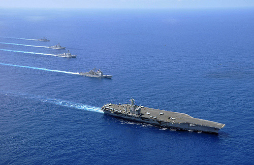 "U.S. Navy's Pacific Presence to Expand, Panetta Says | Bloomberg News By Gopal Ratnam and Daniel Ten Kate  U.S. naval power in the Pacific will increase as the Pentagon rebalances American forces toward the Asia-Pacific region, Defense Secretary Leon Panetta said in Singapore while calling on countries to beef up their capacity. By 2020, the ""Navy will re-posture its forces from today's roughly 50/50 percent split between the Pacific and the Atlantic to about a 60/40 split between those oceans — including six aircraft carriers, a majority of our cruisers, destroyers, Littoral Combat Ships, and submarines,"" Panetta said yesterday at the Shangri-La Dialogue. He heads to Vietnam today before a visit to India. Panetta is using his first visit to the annual Asian security conference to elaborate on the U.S. military's revamped global strategy laid out in January. Pentagon officials have billed the approach as an effort to focus more attention on a region where China's growing economic and military power is causing friction with its neighbors. Countries in the region must develop their own military capacities as well as create rules to deal with territorial disputes in the South China Sea, Panetta said. Panetta is trying to show support for allies in the region without encouraging them to be reckless in dealings with China, said Bonnie Glaser, an Asia specialist at the Center for Strategic and International Studies in Washington. Panetta, more than any other U.S. official, has made it clear ""we want the countries in the region to have the capability to defend themselves and not take for granted or rely on the U.S. to come and put out fires when there's a problem,"" Glaser said in an interview in Singapore. FULL ARTICLE (Bloomberg News) Photo: Official U.S. Navy Imagery/ Flickr"