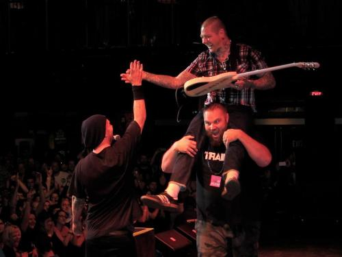 "rancidofficial:  LF on ""The Viking's"" shoulders giving Tim a hi-5 in Boston. photo by: Felicia Leesh"