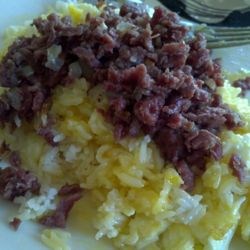 Breakfast. Corned Beef w/ a Sunnyside up egg smashed up into some garlic rice. ;) #yup #ieatgood #icook #filipinoatheart #cheatday =P (Taken with Instagram)
