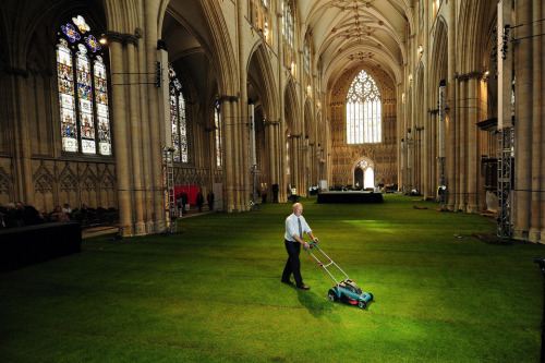 John Giles/PA/AP Photo The nave of York Minster cathedral in northern England was prepared Wednesday for a dinner. The floor was covered with real grass for a dinner that hundreds of guests will attend to celebrate Queen Elizabeth II's Diamond Jubilee.