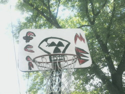 Some kids that live around the corner from me painted this on their hoop.  I want to play basketball with them.