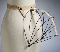 vicfangirlguide:  'The New Phantom' steel wire bustle from 1884 which was designed to minimize discomfort as it compressed when the wearer sat down and sprang back out when they stood up. A variation of this design was released for Queen Victoria's Golden Jubilee in 1887. It was fitted with a musical box which played 'God Save the Queen' every time the wearer sat down.
