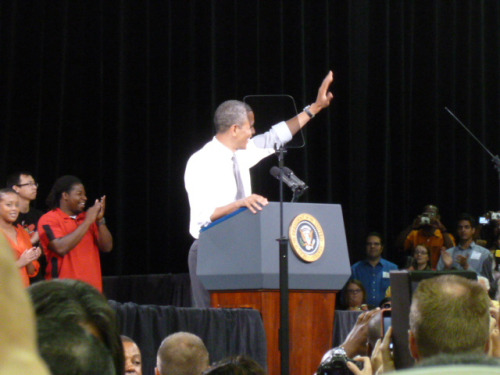 In shirt sleeves, President Barack Obama waves to UNLV students as he begins his speech on the economy and college affordability. He announced a plan to cap student loan payments at 10% of payees discretionary income. (Photo taken by CBS News' Mark Knoller)