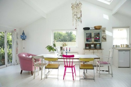 Basically my dream dining room. I'm not allowed to have un-matching chairs. I am missing out. This is so lovely! And what a beautiful kitchen cabinet  myidealhome:  white + colors (via Interior design inspirations / pretty in pink)