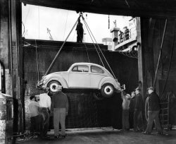 Nov. 26, 1956: Longshoreman unload German cars — Volkswagen and Mercedes Benz — from the American Scout at Pier 61 of the U.S. Lines. Photo: Barney Ingoglia/The New York Times