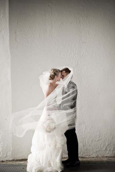 I love this whole 'wind-swept-with-my-man-in-my-veil' look. Must try it on the day! Photo Credit: Lavara Photography via Style Me Pretty
