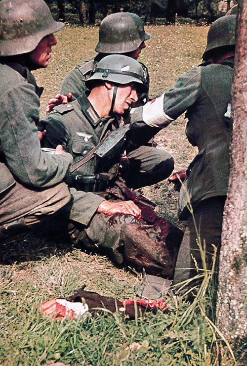 collective-history:  German soldier with his arm blown off on the Eastern Front during World War 2.