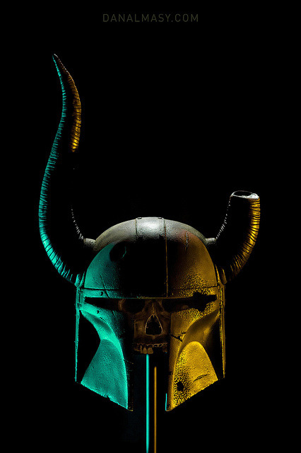 "Dovahfett Final by Volpin  Project completed for the ""As You Wish Helmet Project"" to benefit the Make-a-Wish foundation. More information can be found here: www.facebook.com/asyouwishproj This project provides artists with a raw ""blank"" casting of a helmet from the Star Wars series and allows them to alter it to their creative desires. As I've been playing a lot of Skyrim lately, I wanted to do an aged helmet adorned with horns and badly corroded over the years. My end goal was to make a piece that looks as though it has just been unearthed with all the scars and damage as they happened years ago. Photography for the final project courtesy of Dan Almasy: www.danalamasy.com Helmet raw casting by ""Fett Pride"""