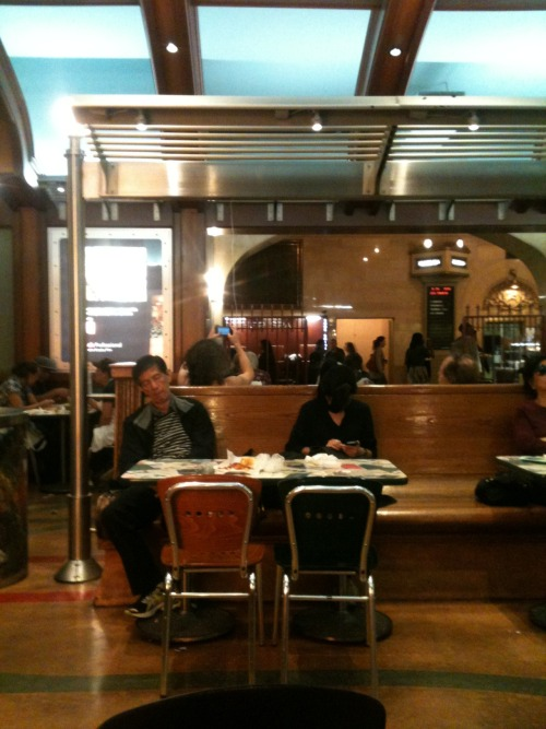 I thought it was odd but no one else seemed to notice. At Grand Central this girl had apparently clambered up onto the table to reach the electrical sockets that are on the same lines as the lights, and then plugged in her iPhone whose cord was just long enough so it dangled above her head. Like a little glowing technological halo. And then she'd reach up awkwardly and type on it. The dedication we have to these things is pretty impressive…