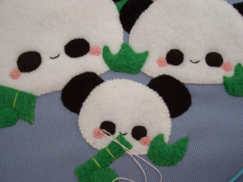 Sewing the finishing touches to some pudding panda fabric wall art. I sold the first one at Anime North, but I'm making another for my online shop!