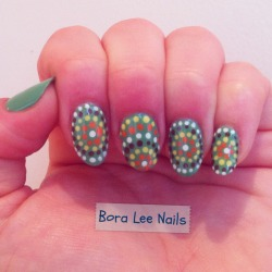 Aboriginal dot nails! Boomerang-inspired from this rad website. Colors used: Essie: Mojito Madness, Little Brown Dress Sally Hansen: White Out, Mellow Yellow, Sun Kissed