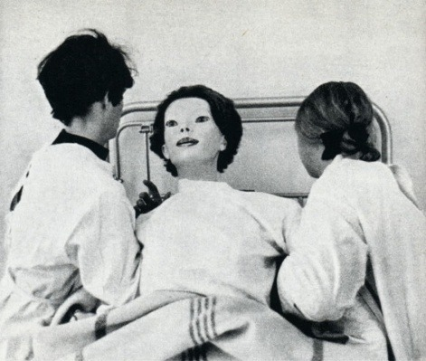 "haventhadenough:   The Expressionless  In June of 1972, a woman appeared in Cedar Senai hospital in nothing but a white gown covered in blood. Now this in itself should not be too surprising as people often have accidents nearby and come to the nearest hospital for medical attention. But there were two things that caused people who saw her to vomit and flee in terror. The first, being that she wasn't exactly human. She resembled something close to a mannequin, but had the dexterity and fluidity of a normal human being. Her face, was as flawless as a mannequins, devoid of eyebrows and smeared in make-up. That's the other reason people were throwing up or fleeing in terror. She had a kitten clenched in between her teeth, her jaws clamped so unnaturally tightly around it to the point where no teeth could be seen, the blood was still squirting out over her gown and onto the floor. She then pulled it out of her mouth, tossed it aside and collapsed. From the moment she stepped through the entrance to when she was taken to a hospital room and cleaned up before being prepped for sedation, she was completely calm, expressionless and motionless. The doctors had thought it best to restrain her until the authorities could arrive and she did not protest. They were unable to get any kind of response from her and most staff members felt too uncomfortable to look directly at her for more than a few seconds. But the second the staff tried to sedate her, she fought back with extreme force. Two members of staff holding her down as her body rose up on the bed with that same, blank expression. She turned her emotionless eyes towards the male doctor and did something unusual. She smiled. As she did, the female doctor screamed and let go out of shock. In the womans mouth were not human teeth, but long, sharp spikes. Too long for her mouth to close fully without causing any damage… The male doctor stared back at her for a moment before asking ""What in the hell are you?"" She cracked her neck down to her shoulder to observe him, still smiling. There was a long pause, the security had been alerted and could be heard coming down the hallway. As he heard them, she darted forward, sinking her teeth into the front of his throat, ripping out his jugular & letting him fall to the floor, gasping for air as he choked on his own blood. She stood up and leaned over him, her face coming dangerously close to his as the life faded from his eyes. She leaned closer and whispered in his ear. ""I…am….God…."" The doctors eyes filled with fear as he watched her calmly walk away to greet the security men. His last ever sight would be watching her feast on them one by one. The female doctor who survived the incident named her ""The Expressionless"". There was never a sighting of her again."