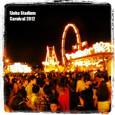 I went to the Aloha Stadium carnival today with Brandon. It was really fun, I had an awesome time. We started out at dinner. We are at Buca di Pepo. Sooooo delicious. We had cheese ravioli in meat sauce. Then, headed to the carnival and rode all the awesome rides (Fire Ball, Rave, and Techno Power). THEN, got a whole bunch of candy for the midnight premier of Prometheus. Such an amazing film. It was so visually striking. Ridley Scott really out did himself this time. I will definitely be seeing it again!