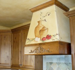 Stove hood mural in Castle Pines, Colorado.  I painted this in a kitchen which was fairly open to the rest of the main floor of the home (dining room, living room etc) so the homeowner wanted something unique but subtle. I used my favorite technique of layering thick glazes to create this fresco like effect.
